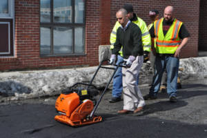 Mayor Jorge Elorza repairing potholes.
